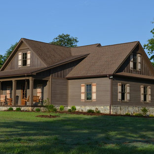 Large traditional brown two-story wood exterior home idea in Charlotte with a hip roof
