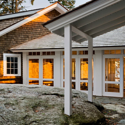 Example of a beach style wood exterior home design in Portland Maine