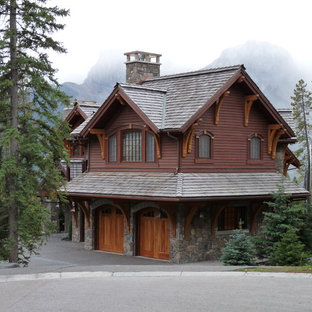 This is an example of a rustic exterior in Vancouver with wood cladding.