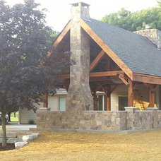 Rustic Exterior by Above and Beyond Companies, Inc.