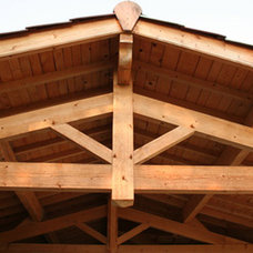 Traditional Exterior by American Pole and Timber