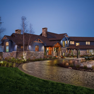 This is an example of a country exterior in New York with wood siding.