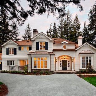 Large elegant white three-story wood exterior home photo in San Francisco with a hip roof