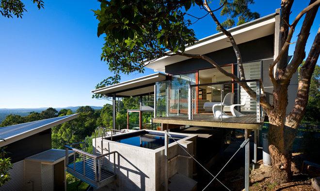 Современный Фасад дома by Bark Design Architects