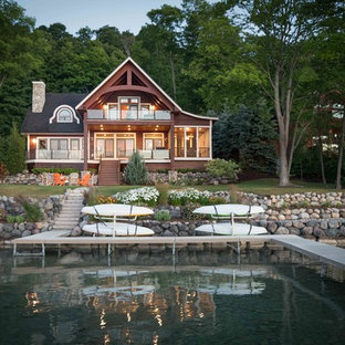 Inspiration for a rustic brown two-story wood house exterior remodel in Other with a shingle roof