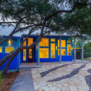 Mid-sized eclectic blue two-story exterior home idea in Austin with a metal roof
