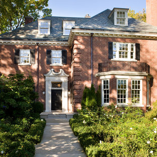 Large traditional two-storey brick red exterior in Toronto.