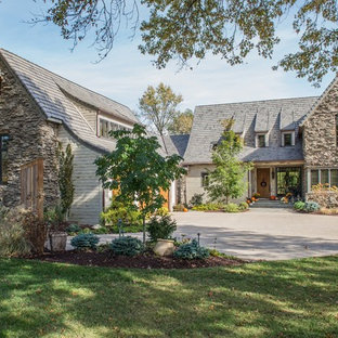 Large french country beige two-story mixed siding exterior home photo in St Louis