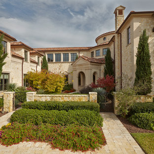 Inspiration for a mediterranean exterior home remodel in Dallas