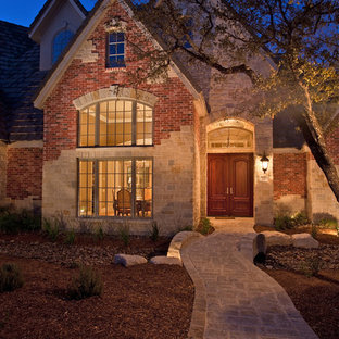 Traditional two-story mixed siding gable roof idea in Austin