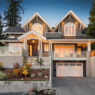 Inspiration for a large traditional two-storey grey house exterior in Vancouver with wood siding, a hip roof and a shingle roof.