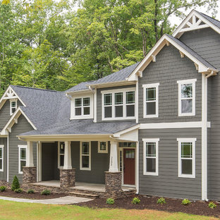 Large arts and crafts gray two-story exterior home photo in Raleigh
