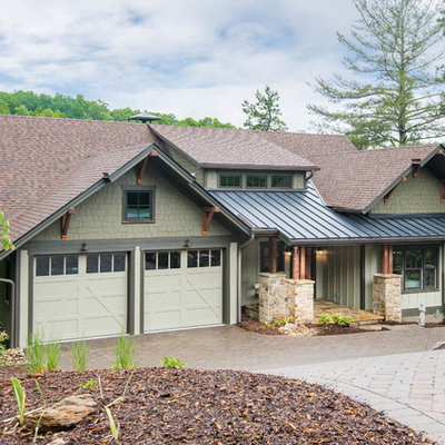 Inspiration for a mid-sized craftsman beige two-story wood exterior home remodel in Other with a mixed material roof
