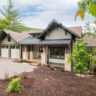 Mid-sized craftsman beige two-story wood exterior home idea in Other with a mixed material roof