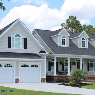 Mid-sized traditional beige two-story concrete fiberboard gable roof idea in Wilmington