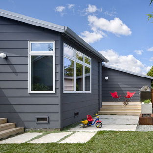 Gey classic one floor house exterior in San Francisco with concrete fibreboard cladding.