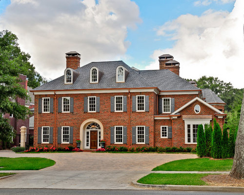 Example Of A Classic Brick Exterior Home Design In Charlotte