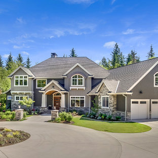 Traditional gray two-story mixed siding house exterior idea in Seattle with a hip roof and a shingle roof