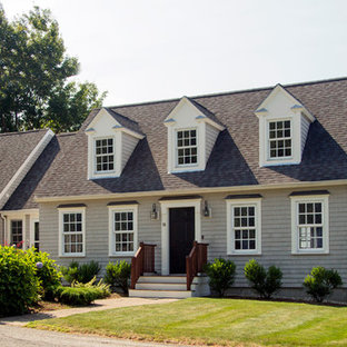 Mid-sized traditional gray one-story wood gable roof idea in Boston