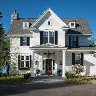 Example of a classic white two-story wood exterior home design in Detroit