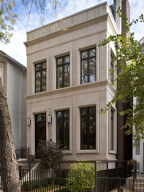 Example of a transitional two-story exterior home design in Chicago