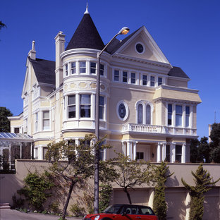 Large victorian three-story wood gable roof idea in San Francisco