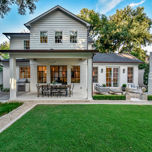 This is an example of a traditional two-storey white house exterior in Austin with mixed siding, a gable roof and a shingle roof.