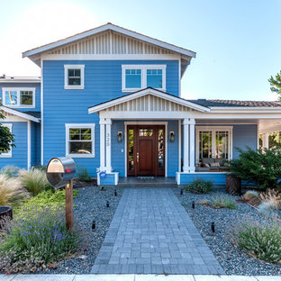 Example of a large classic blue two-story wood gable roof design in San Francisco