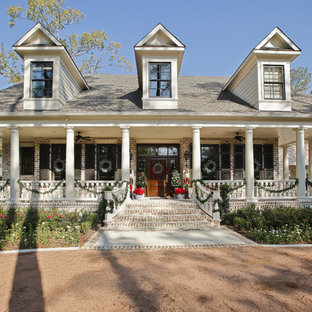 Inspiration for a timeless two-story brick exterior home remodel in Houston