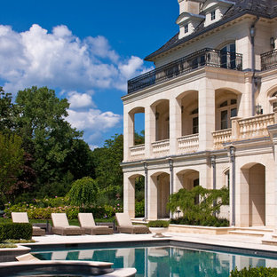 Inspiration for a timeless beige three-story stone exterior home remodel in New York