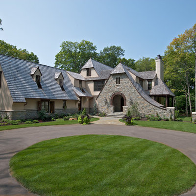 Inspiration for a timeless stone exterior home remodel in Minneapolis with a clipped gable roof