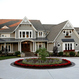 Traditional gray two-story wood exterior home idea in Indianapolis with a mixed material roof