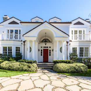 Traditional white two-story wood exterior home idea in Houston with a shingle roof