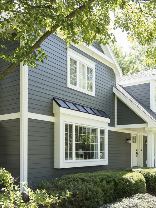 Example of a mid sized classic blue two story exterior home design in chicago