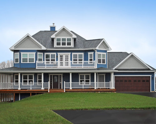 example of a classic blue three story exterior home design in other with a hip - Exterior House Colors Blue