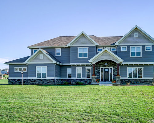example of a classic blue two story mixed siding exterior home design in other with