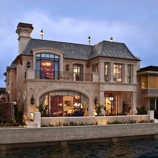Inspiration for a timeless two-story exterior home remodel in Orange County
