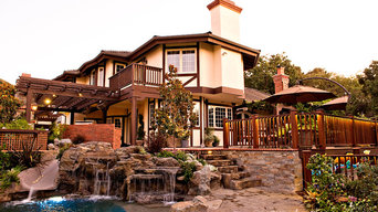 Traditional Landscape, Fireplace, and Swimming Pool