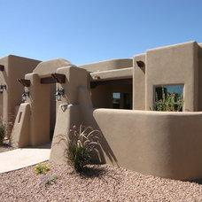 Eclectic Exterior by Villa Custom Homes, Inc.