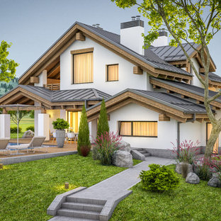 Mid-sized modern white two-story mixed siding exterior home idea in San Diego with a metal roof
