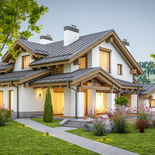 Example of a mid-sized minimalist white two-story mixed siding exterior home design in San Diego with a metal roof