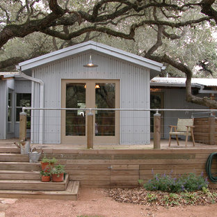 Inspiration for an industrial metal gable roof remodel in Austin