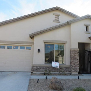 Mid-sized southwest beige one-story stucco exterior home photo in Phoenix
