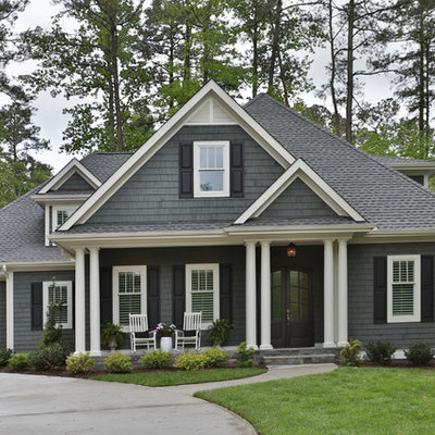 Inspiration for a large transitional gray two-story wood house exterior remodel in Raleigh with a hip roof and a shingle roof