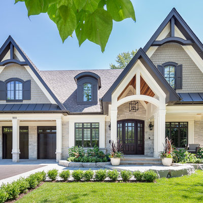 Large transitional beige two-story wood gable roof photo in Toronto