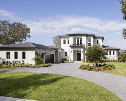 Example Of A Transitional White Two Story Exterior Home Design In Orlando  With A Tile