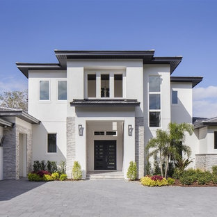 Large Minimalist White Two Story Stucco Gable Roof Photo In Orlando With A  Tile Roof