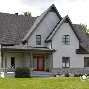 Inspiration for a large transitional white two-story mixed siding exterior home remodel in New York