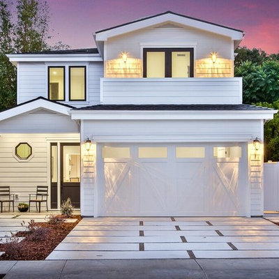 Mid-sized transitional white two-story wood house exterior idea in Orange County with a hip roof and a shingle roof