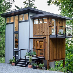 Mid-sized contemporary three-story mixed siding flat roof idea in Vancouver